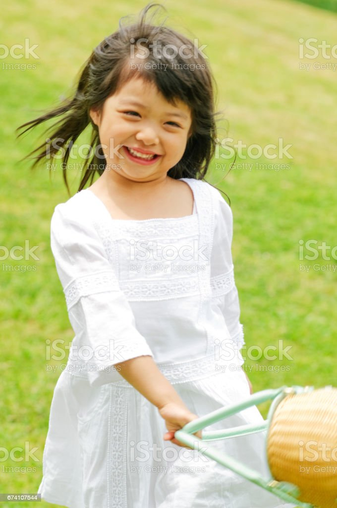 Girls have a goodie bag, skipping stock photo