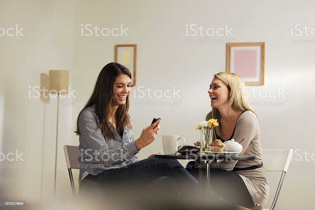Girls having a conversations with a cup of coffee royalty-free stock photo
