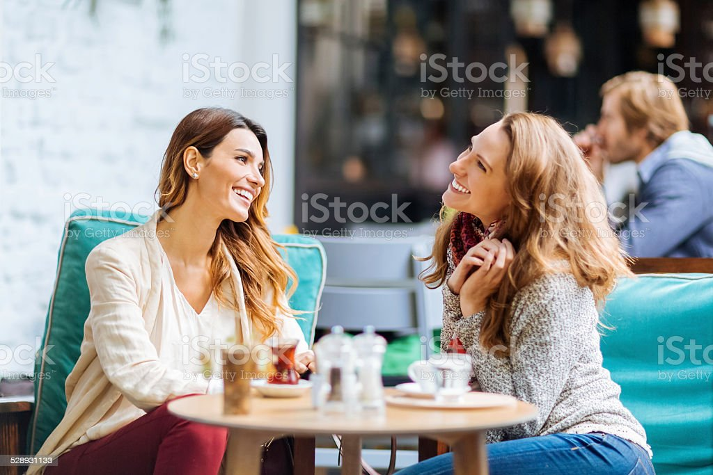 Girls having coffee break stock photo