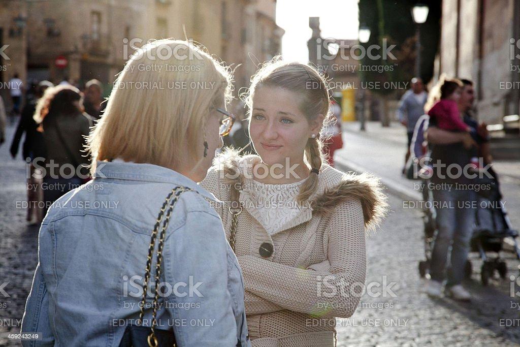 Girls having conversation stock photo