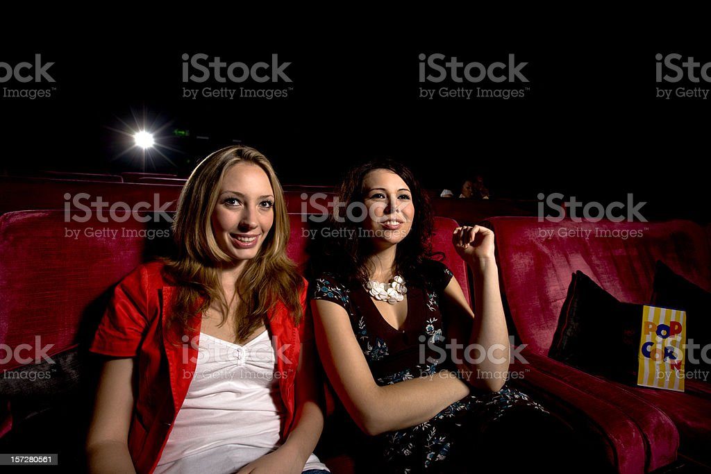 girls having fun at the movies stock photo