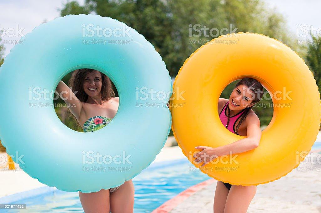 Girls having fun at water park stock photo