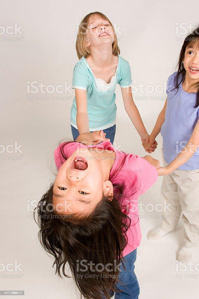 Girls having fun in circle royalty-free stock photo