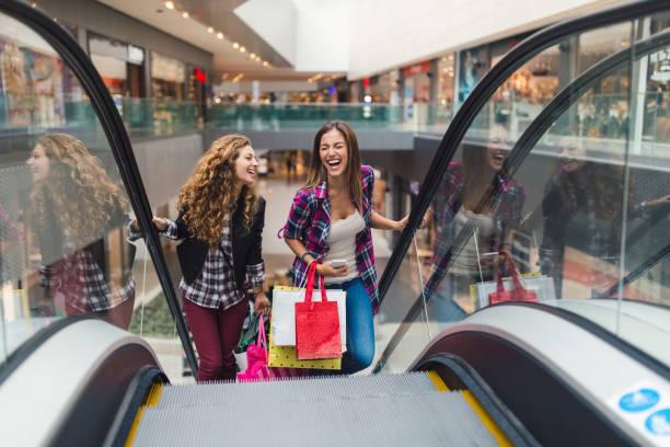 Girls having fun in the shopping center stock photo