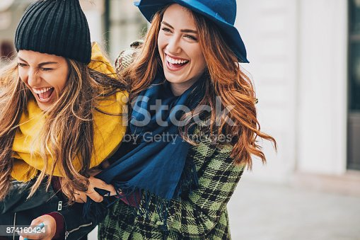 istock Girls having great time together 874160424