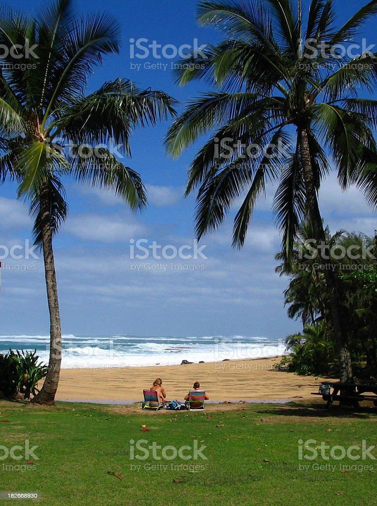 Girls having lunch on a Maui Hawaii beach royalty-free stock photo