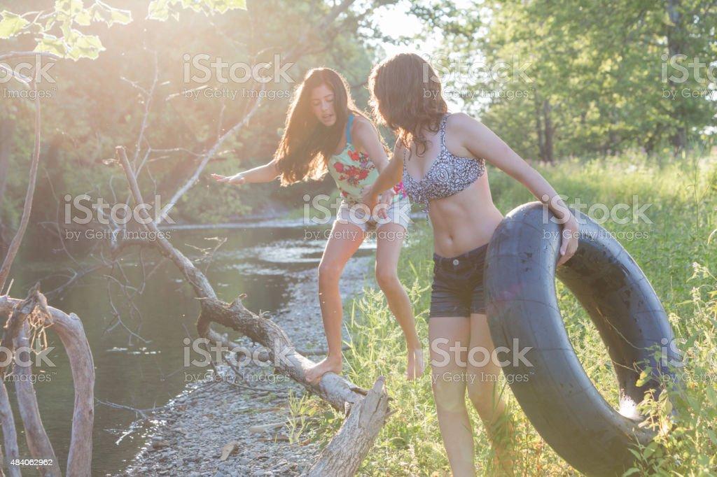 Girls Helping Hand stock photo