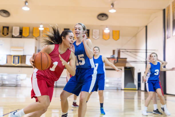 girls high school basketball game - high school sports stock pictures, royalty-free photos & images