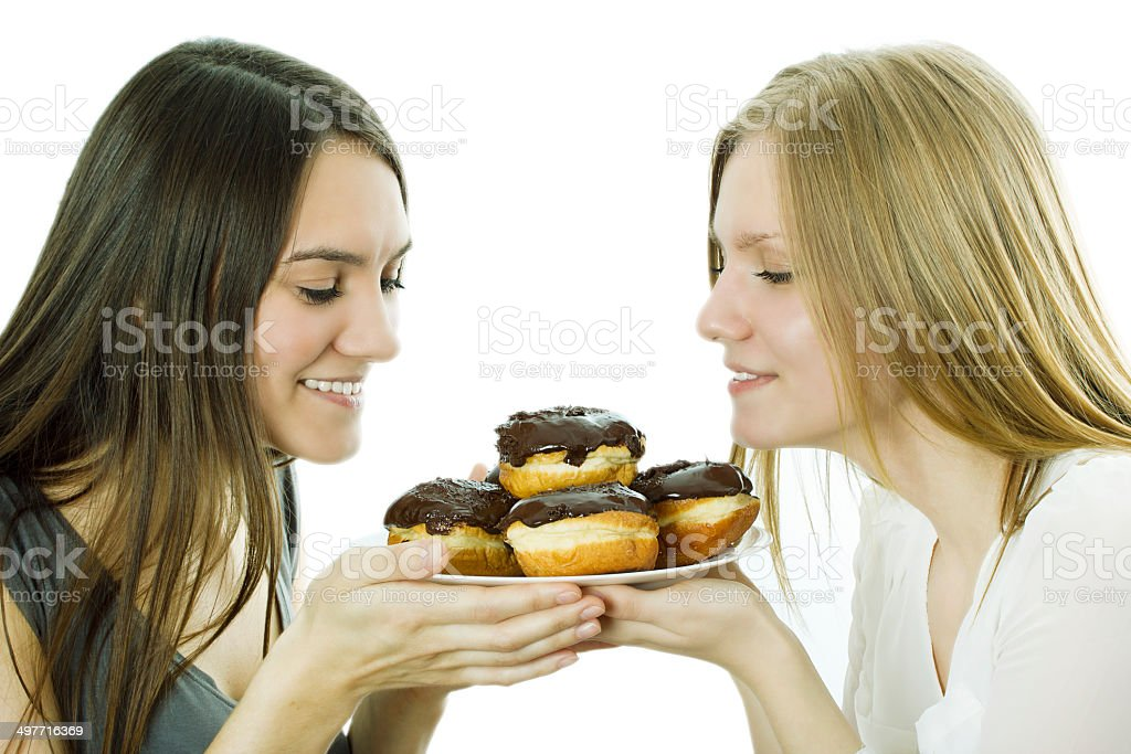 Girls hold cakes on a plate royalty-free stock photo