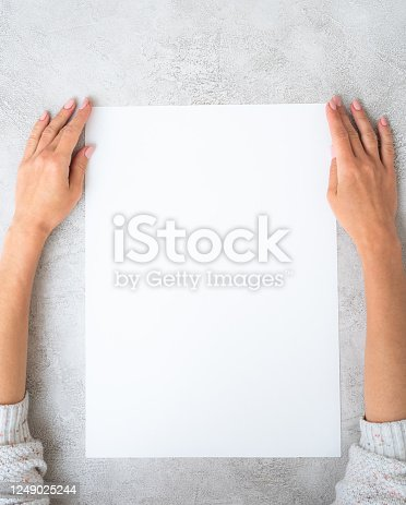 istock Girl's holding a paper 1249025244