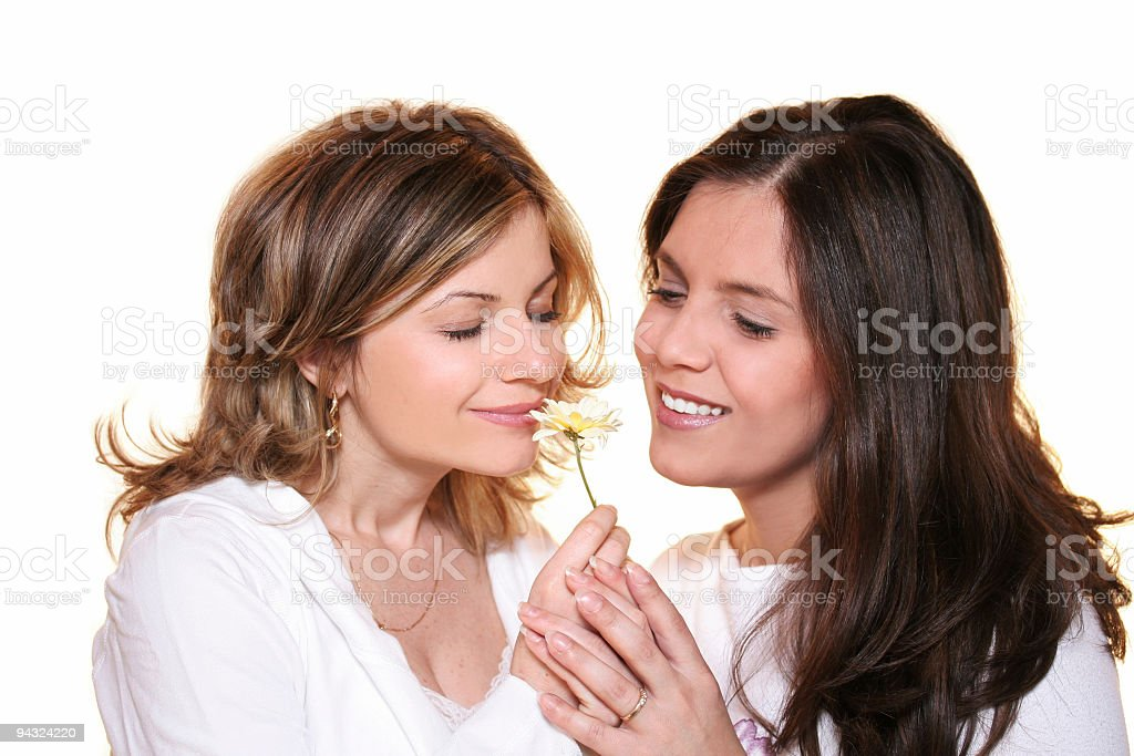 girls holding and smelling flower royalty-free stock photo