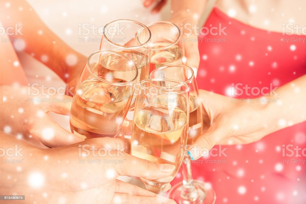 girls holding glasses filled with champagne at new year party ストックフォト