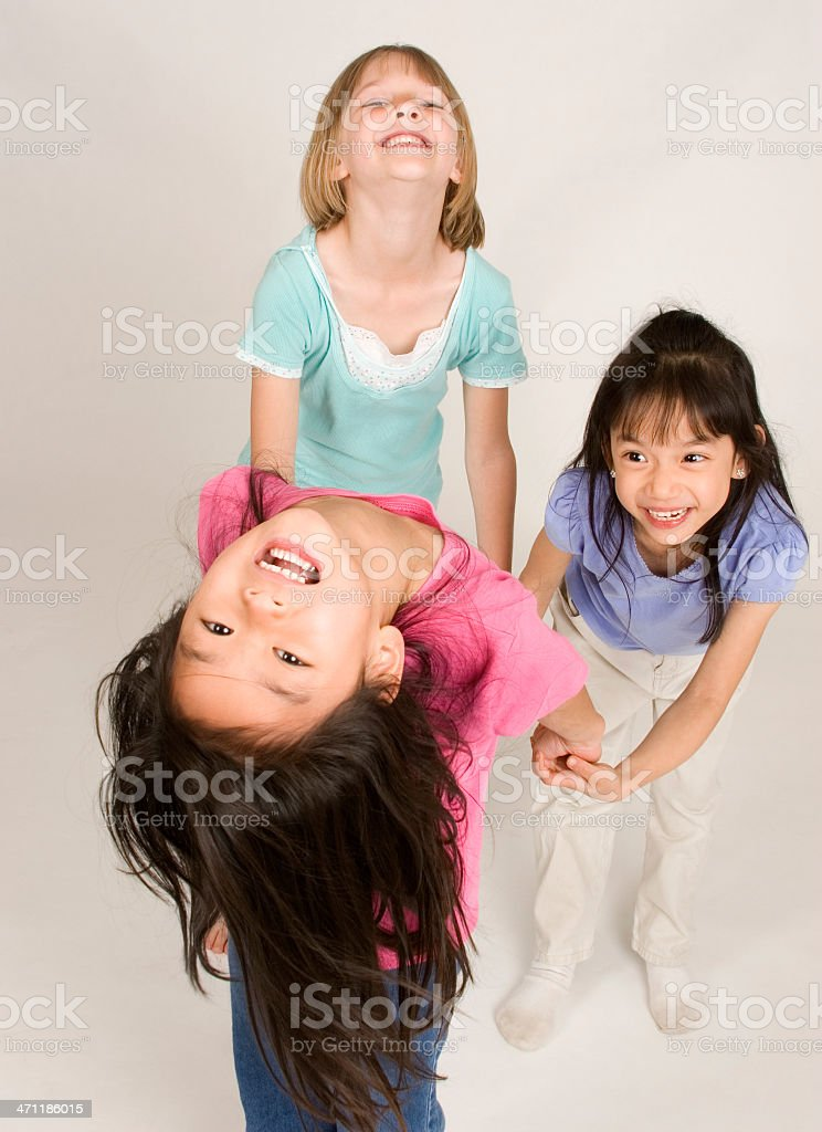Girls holding hands and playing royalty-free stock photo
