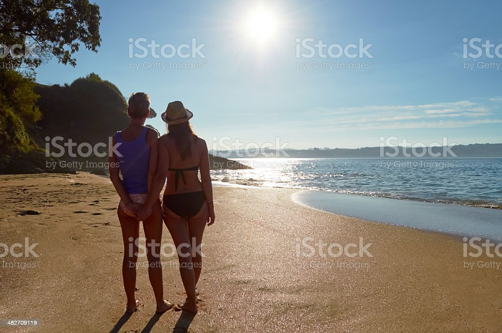 Girls holding hands. stock photo