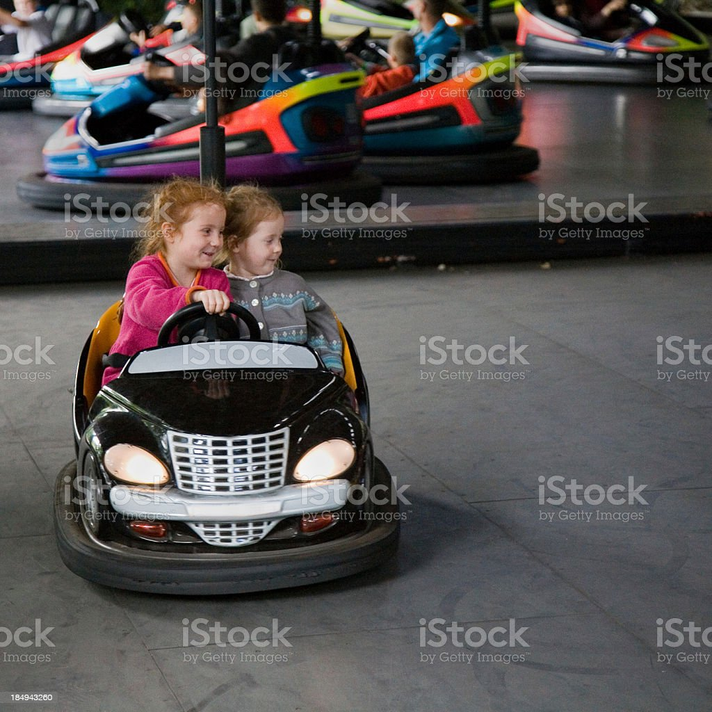 girls in a dodgem at the amusement park royalty-free stock photo