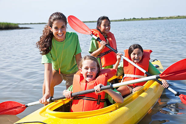 Girls in a double kayak stock photo