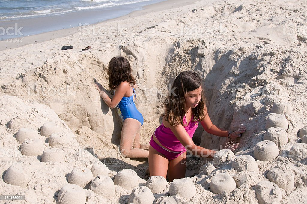 Girls in a Hole stock photo
