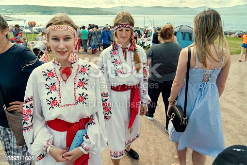Parnaia, Sharypovskiy district, Krasnoyarsk region, RF - 5 July 2019: Girls in folk Ukrainian costumes walk along a shopping street at the Karatag music festival. Krasnoyarsk region. Russia.