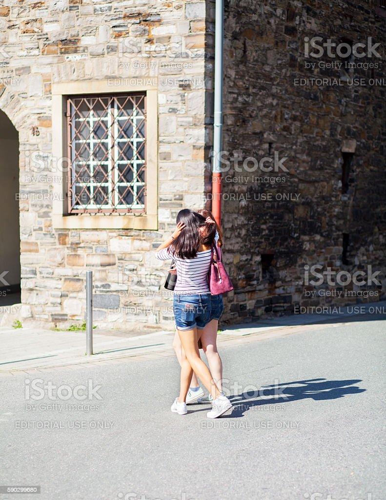 Girls in hot pants at summertime royaltyfri bildbanksbilder