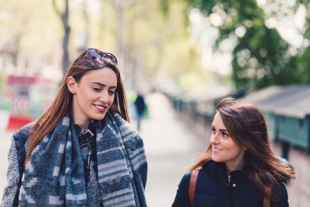 Girls in Paris walking and talking stock photo