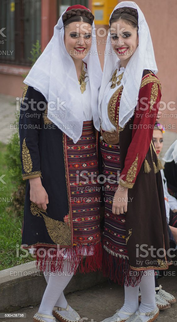 Girls in  serbian   national  folk  costume stock photo