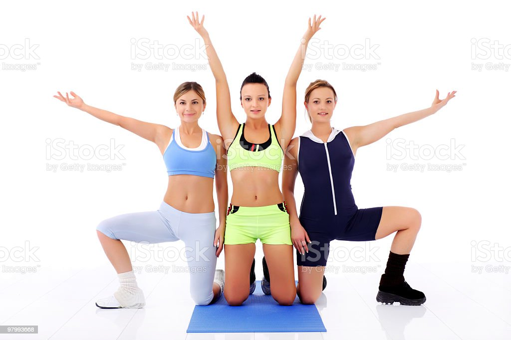 Girls in sporty pose with raised hands. royalty-free stock photo
