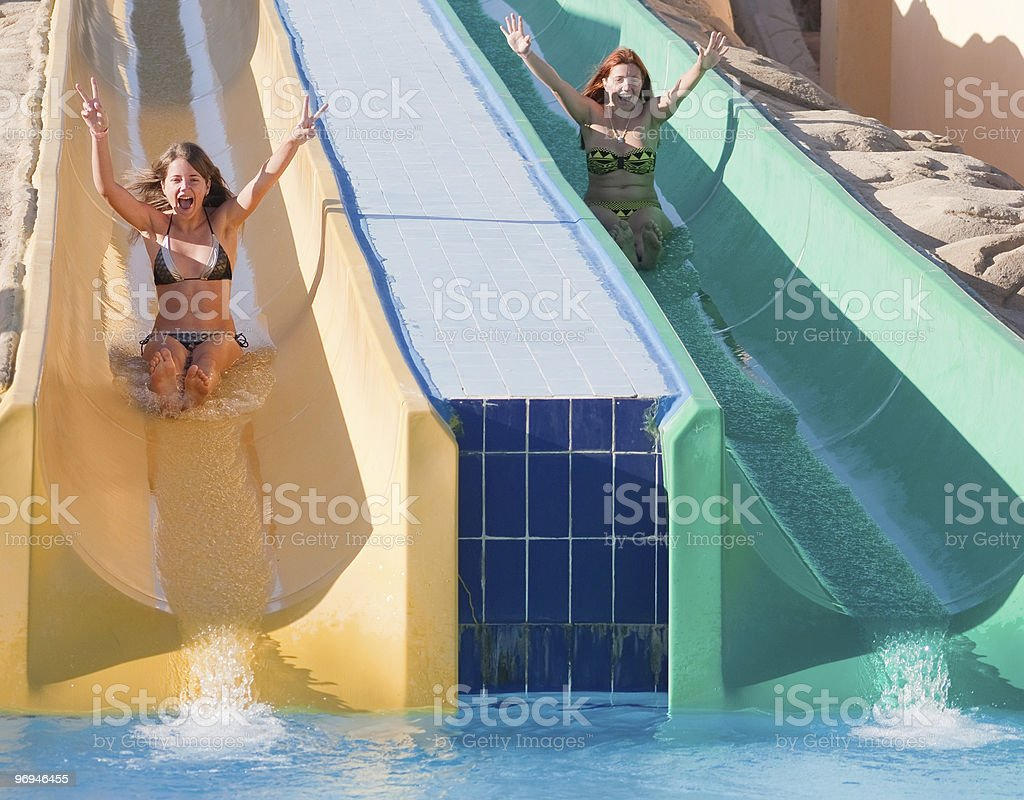 girls in swimming pool water slide royalty-free stock photo