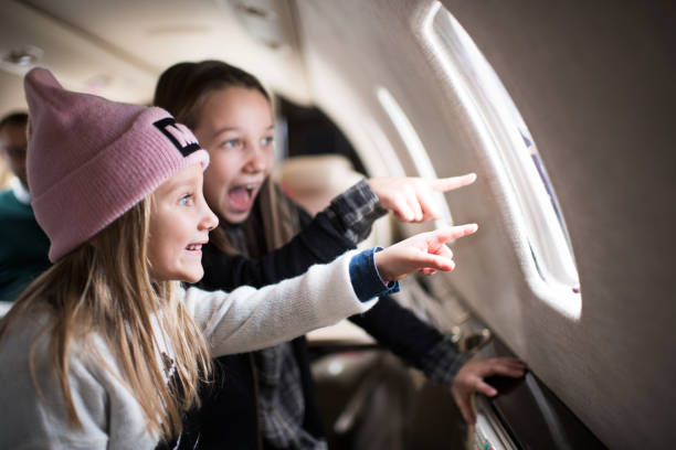 Girls in the airplane stock photo