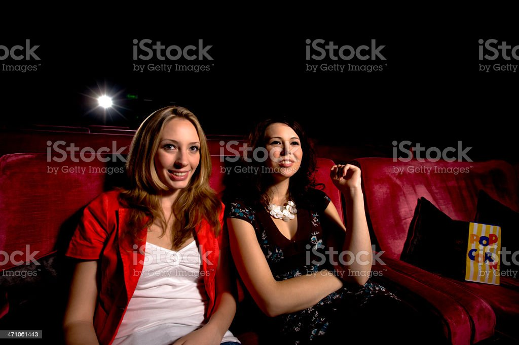 girls in the cinema stock photo