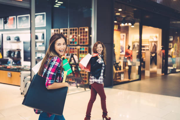 girls in the shopping mall - cheap stock pictures, royalty-free photos & images