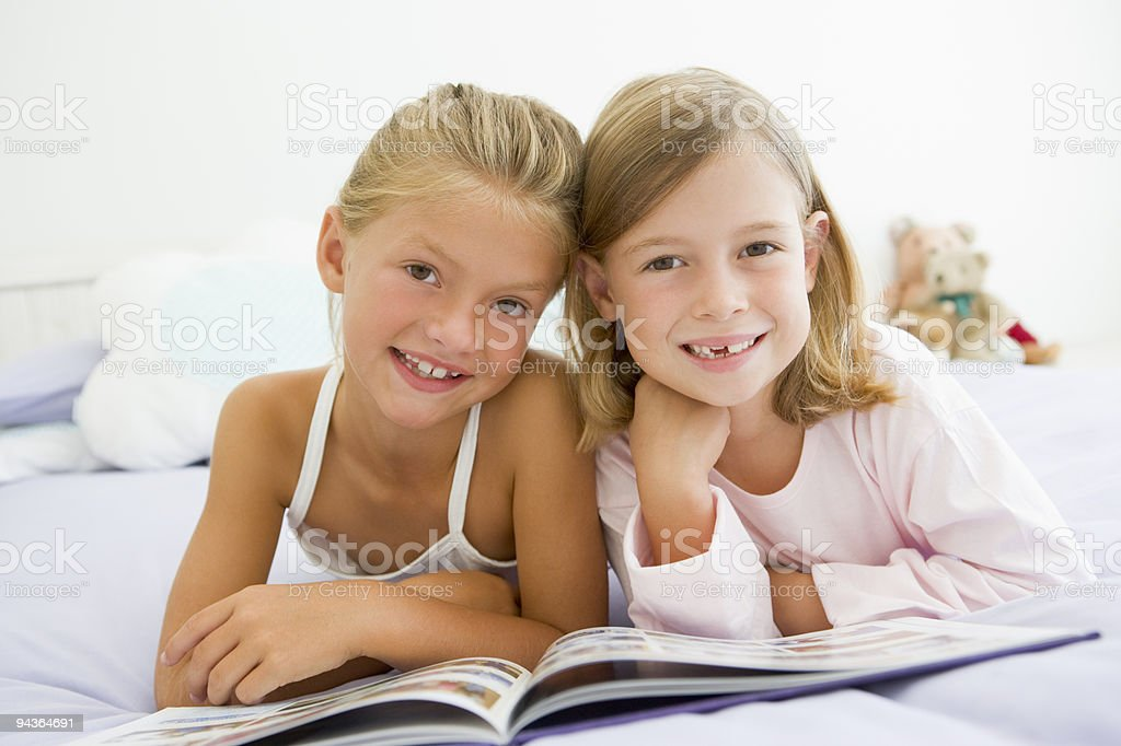 Girls In Their Pajamas, Reading A Book stock photo