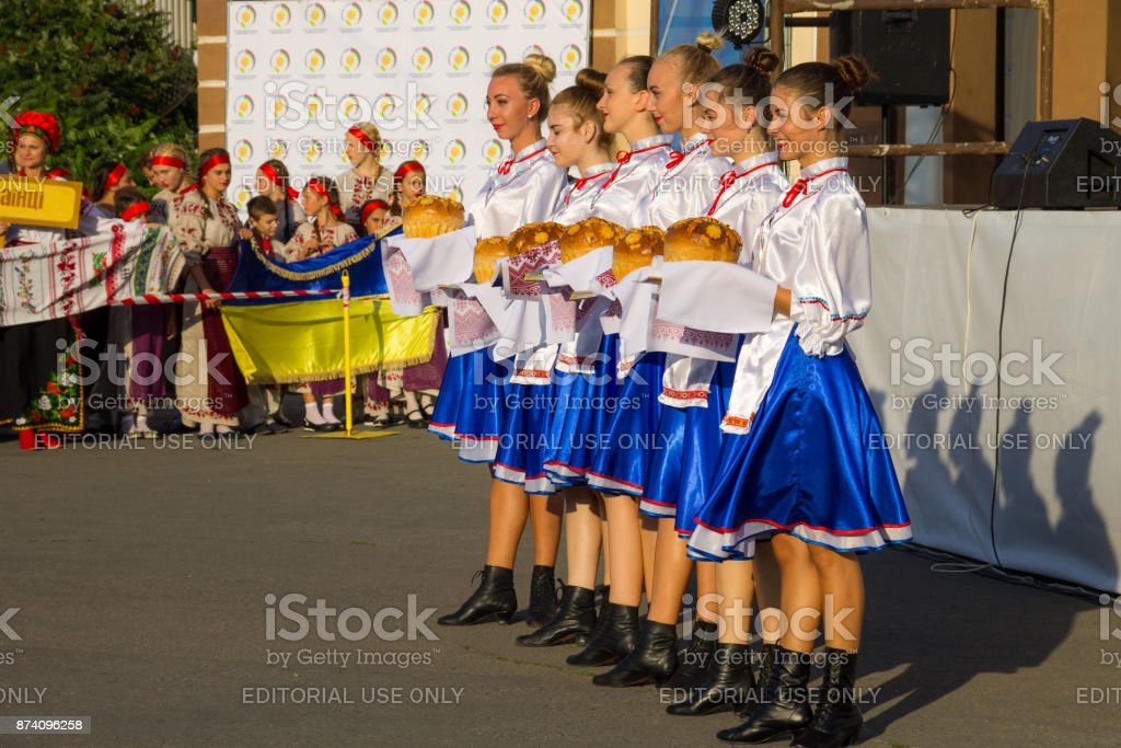 Girls in ukrainian traditional clothing prepare to welcome guests of festival stock photo