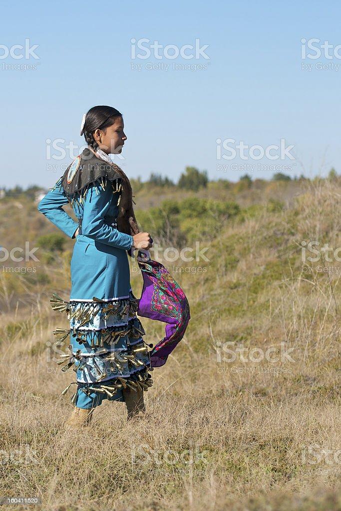 Girls Jingle Dress Dancer In Field stock photo