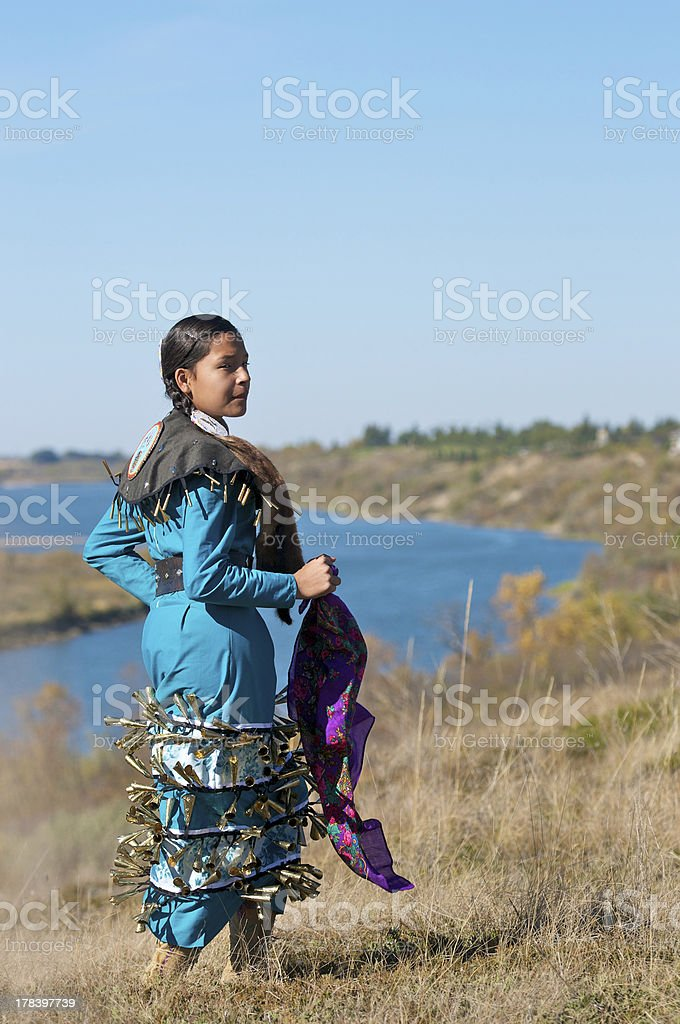 Girls Jingle Dress Dancer River Background stock photo