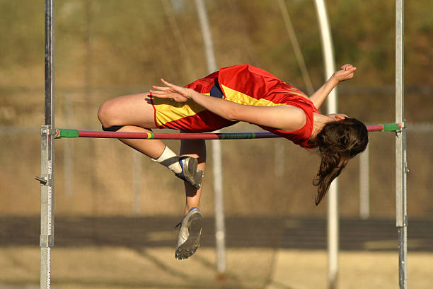 Girls Jump High Taken using a 300mm f2.8 lens. high school sports stock pictures, royalty-free photos & images