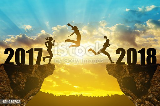 istock Girls jump to the New Year 2018 654939702