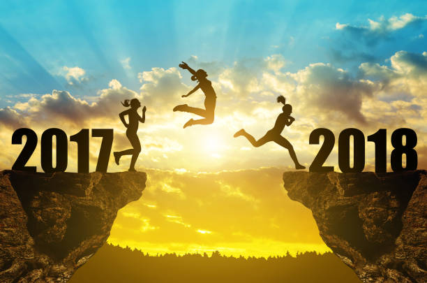 Girls jump to the New Year 2018 stock photo