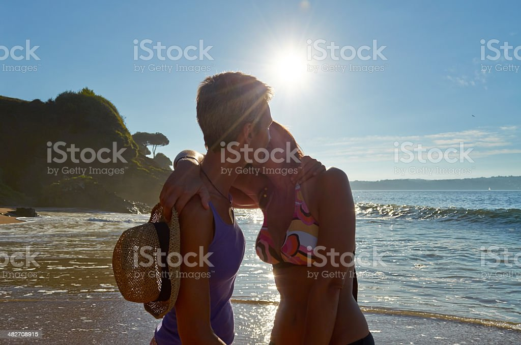 Girls kissing each other. stock photo