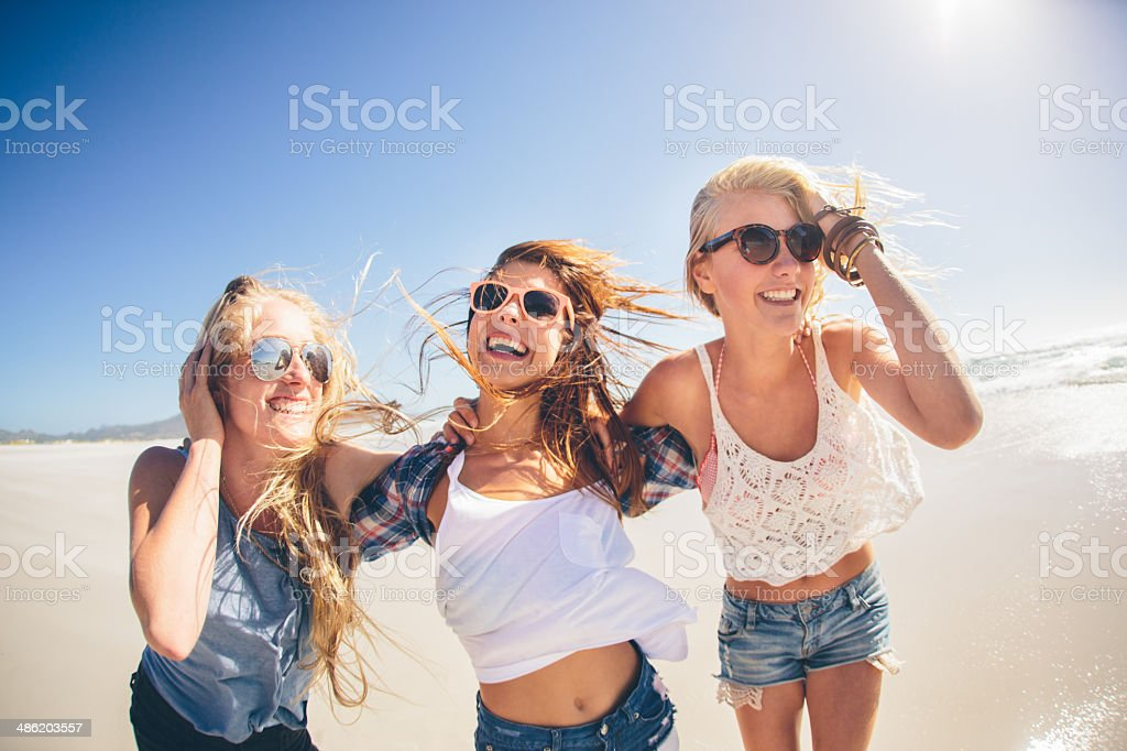 Girls laughing on the beach royalty-free stock photo