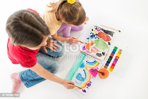 istock Girls Learning to Draw 619369288