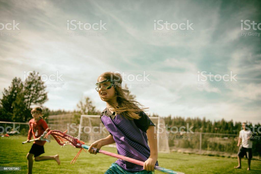 Girls loving playing field sports stock photo