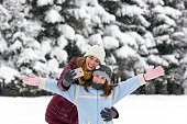 Cheerful  two girls making selfie in snow background.