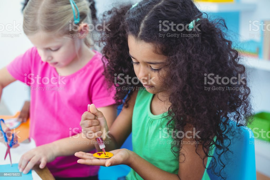 Girls making arts and crafts together stock photo