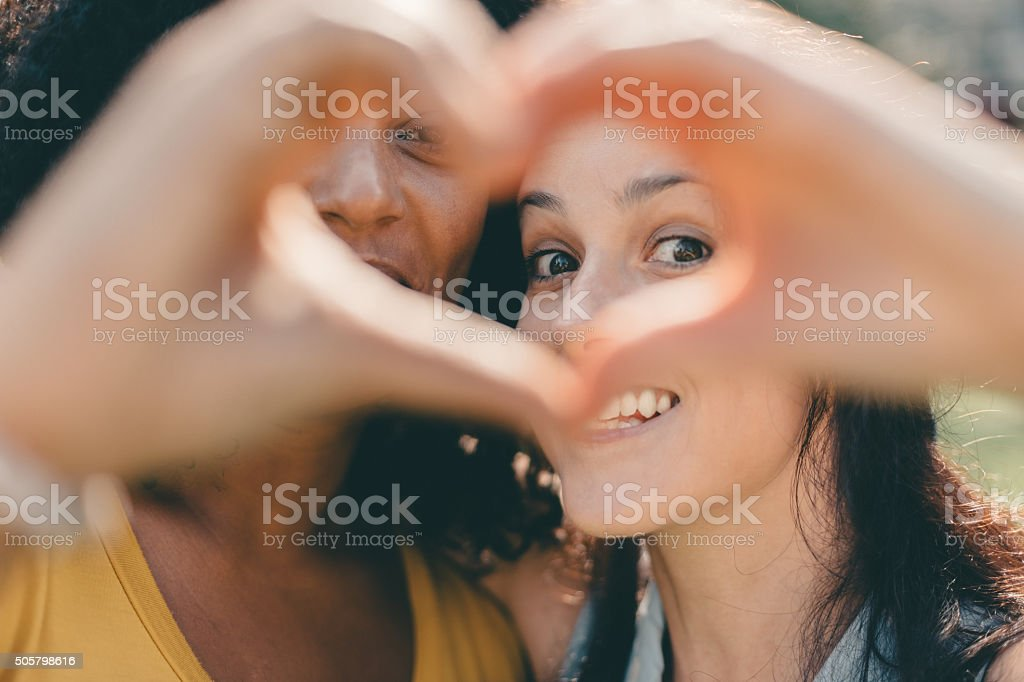 Girls Making Heart Shaped Symbol With Hands Stock Photo More