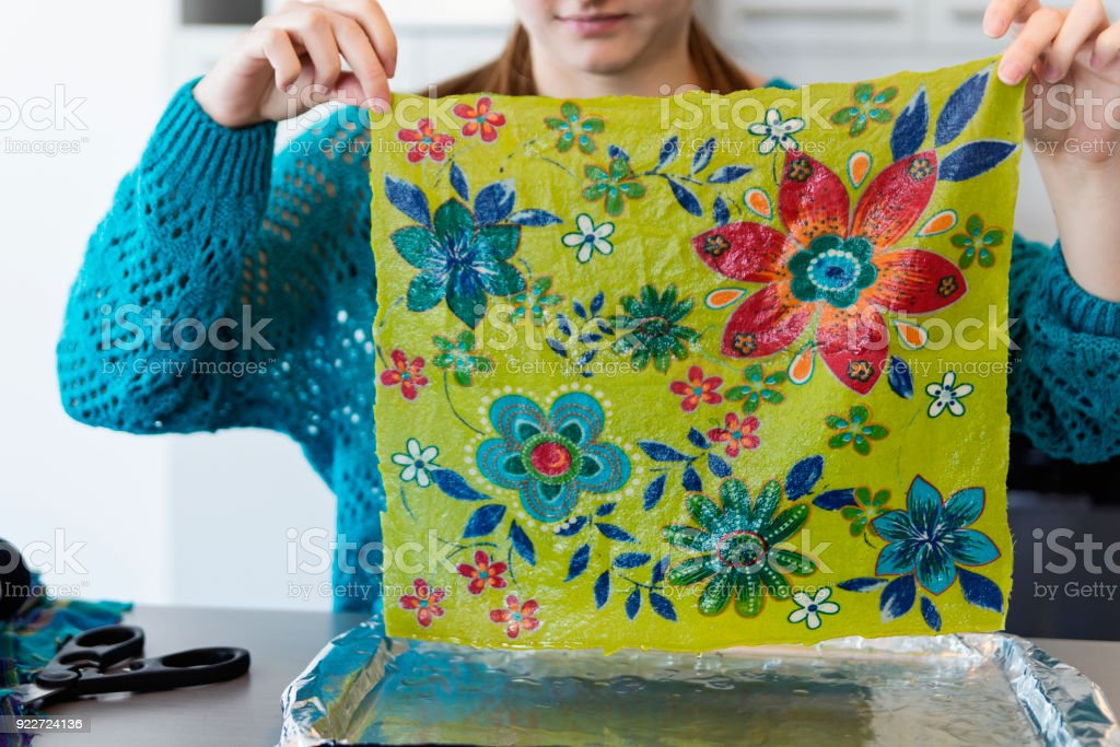Girls making reusable eco-friendly food wrap. stock photo
