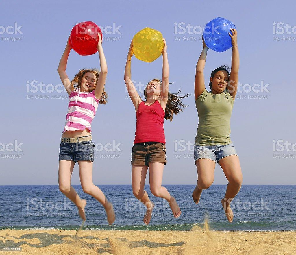 Girls on a beach royalty-free stock photo