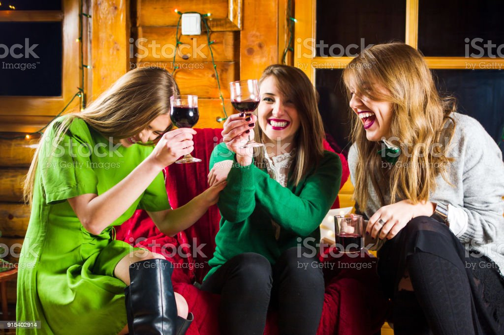 Girls on a home party wearing green outfits stock photo