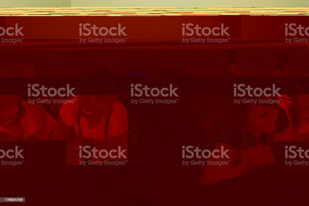 Girls on bed using laptop royalty-free stock photo