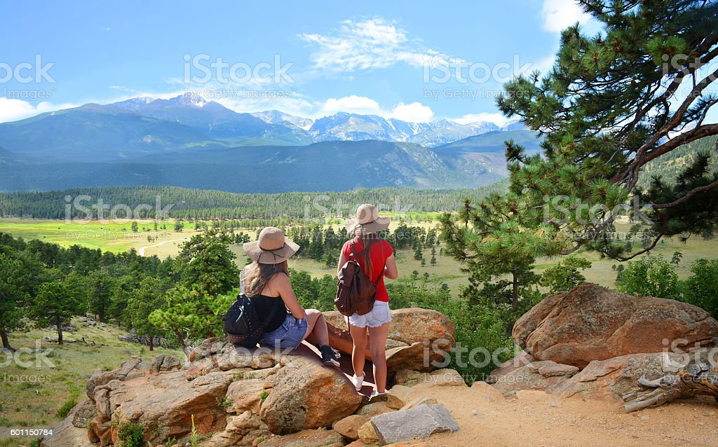 Girls on hiking trip in  Colorado mountains. stock photo