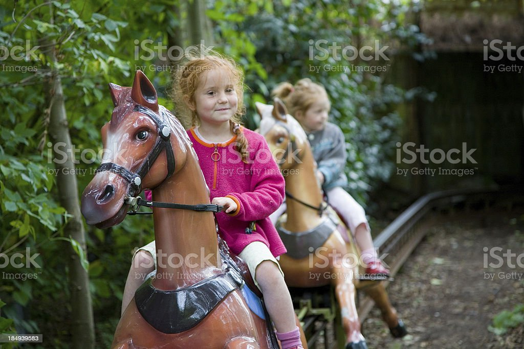 girls on horses at fairground royalty-free stock photo